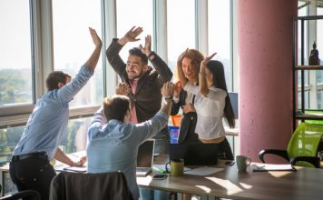 people celebrating representing job attractiveness